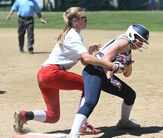JIM VAIKNORAS/Staff photo Amesbury's olivia DeLong tags out a  Lowell Catholic player at first during their game at Amesbury Sunday.