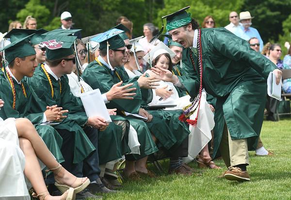 JIM VAIKNORAS/Staff photo Pentucket graduate Noah Longo greets his classmates after getting his diploma at Commencement Saturday morning.