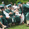 JIM VAIKNORAS/Staff photo Pentucket graduate Noah Longo greets his classmates after getting his diploma at Commencement Saturday morning.