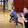 BRYAN EATON/Staff Photo. Youngsters play a game of dodgeball against the counselors at the YWCA Afterschool Program on Tuesday afternoon. The matchup has become a near the end of school year tradition.