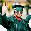 JIM VAIKNORAS/Staff photo Pentucket senior Aaron Peavey waves as he marches in with his classmate at Commencement Saturday morning.