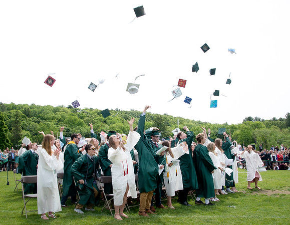 JIM VAIKNORAS/Staff photo Pentucket graduates toss their caps at the end of Commencement Saturday morning.