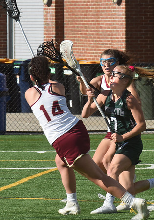 BRYAN EATON/Staff Photo. Newburyport's Lily Spaulding and Abigail Lantz battle for the ball in the first half.