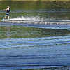 BRYAN EATON/Staff Photo. Lake Gardner was a popular spot on Friday afternoon with bathers, canoers and a water skiier. The weekend may not be ideal for outdoor activities as showers are in the forecast from time to time.