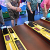 BRYAN EATON/Staff Photo. Bob Morris and Phyllis Gudaitis, both of Salisbury, test their skills at skeeball at Joe's Playland at Salisbury Beach recently. They were on one of this spring's road trips from the Salisbury Senior Center and after the games ate haddock and french fries at the neighboring Lee's Seafood.