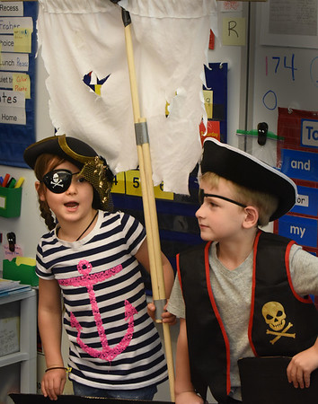 """BRYAN EATON/Staff Photo. Piper Sumner, 7, left, and Gavin Hodge, 6, are dressed appropriately for their roles in """"A Pirate's Life For Me."""""""