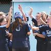 BRYAN EATON/Staff Photo. Bridget Sheehan is cheered on a two-run homer.