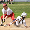 JIM VAIKNORAS/Staff photo Amesbury's Abby Aponas can't get the tag down as a Lowell Catholic player steals second during their game at Amesbury Sunday.