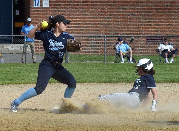 BRYAN EATON/Staff Photo. Triton's Emily Kervielis forces out Essex Tech's #11 and makes a double play.