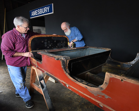 BRYAN EATON/Staff Photo. Amesbury Carriage Museum executive director John Mayer, left, and board memger Tom Pendergast piece together a 1908 Stanley Roadster which will be on display in the Counting House in downtown Amesbury. The group will be having a car show as a fundraiser next week to coincide with Amesbury Days.