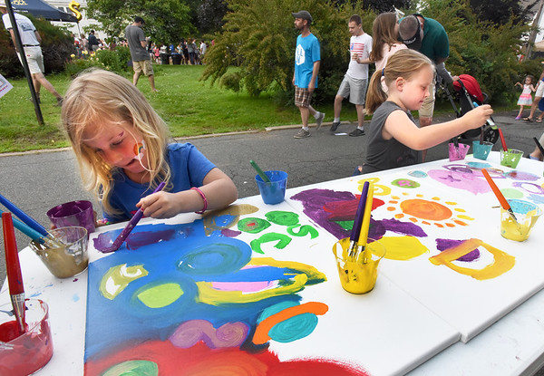 BRYAN EATON/Staff photo. Aubrey Laing, 5, left, and Alexandra Taylor, 7, both of Amesbury work on a mural for the Children's Room at the Amesbury Public Library.