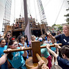 BRYAN EATON/Staff Photo. Nao Santa Maria crew member Sofia Rogriguez shows third-graders from the Tilton School the capstan which lifts and lowers the anchor.