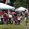 BRYAN EATON/Staff Photo. The nice weather brought out a huge crowd for Amesbury Days' Kids Day in the Park. The line was long for the free sno-cones and popcorn.