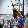 BRYAN EATON/Staff Photo. Third-graders from the Tilton School in Haverhill pose for a photo before boarding the Nao Santa Maria on Newburyport's waterfront.