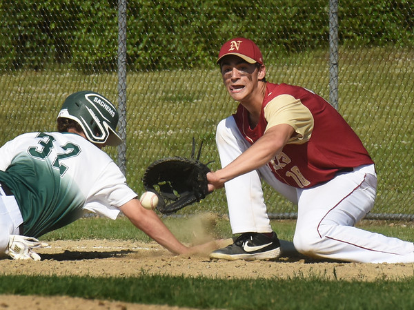 BRYAN EATON/Staff Photo. Pentucket's Joe Lynch makes it back to first base on a steall attempt as Parker McLaren readies for the catch.