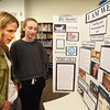 BRYAN EATON/Staff Photo. Audrey Langley, 14, right, shows off her I Am We civics project at the Nock Middle School to her mother Patti. Her project involved ways to fund and encourage the arts.