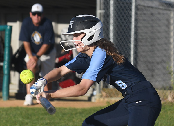 JIM VAIKNORAS/Staff photo Triton's Molly Kimball lays down a bunt Arlington Catholic at Martin Field in Lowell.