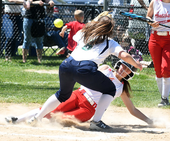JIM VAIKNORAS/Staff photo Amesbury's Olivia Lavasseur scores under the tag of a Lowell Catholic player at Amesbury Sunday.