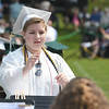 "JIM VAIKNORAS/Staff photo Pentucket senior Kristina Belaya conducts the concert band in ""In The Shining of the Stars""  at Commencement Saturday morning."