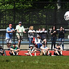 BRYAN EATON/Staff Photo. Despite the strong wind, it was still a pleasant day to watch some high school sports. Spectators soak in the sun as they watch Pentucket boys lacrosse team take on Lowell Catholic.