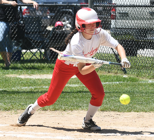 JIM VAIKNORAS/Staff photo Amesbury's Emma DiPietro lays down a bunt against Lowell Catholic at Amesbury Sunday.