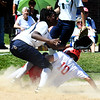 JIM VAIKNORAS/Staff photo Amesbury's julia Campbell slides into 3rd against Lowell Catholic at Amesbury Sunday. She was awarded home plate due to player interference.