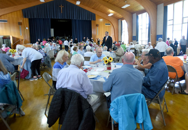 BRYAN EATON/Staff Photo. Holy Famliy Parish Hall was filled during the Amesbury Council on Aging's Annual Summer Cookout. Attendees were treated to hot dogs, hamburger potato salad along with strawberry shortcake.