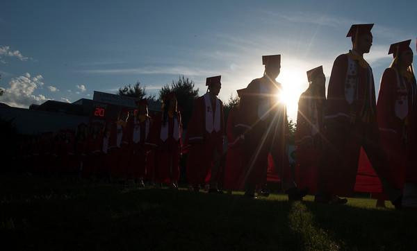 JIM VAIKNORAS/Staff photo Amesbury High School seniors make their way into Landry Stadium for Graduation Friday night.