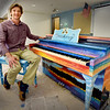 BRYAN EATON/Staff Photo. The Amesbury High Schoo art students of Ryan Jackson painted this piano to be placed in Market Square to replace the one that had been there previously. This one has a good amount of polyurethane to protect it from the elements.