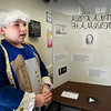 BRYAN EATON/Staff Photo. At the press of a button Nicholas Fowler, 10,  brings Alexander Hamilton to life at Seabrook Elementary School on Wednesday morning. Fourth grade students researched people from American history and presented their findings, in period garb, to parents.