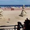 "BRYAN EATON/Staff Photo. People take cell phone photos of the displays from this weekend's Hampton Beach Master Sand Sculpting Classic including Groveland resident Justin Gordon's ""Hulk in 3-D at left."