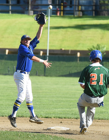 BRYAN EATON/Staff Photo. Rams shortstop Ingraham jumps for the throw but the Ipswich player makes second base.