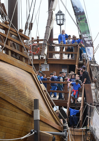 BRYAN EATON/Staff Photo. One group of Tilton School third-graders head off the ship after touring the top deck.