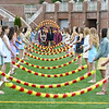 "JIM VAIKNORAS/Staff photo Newburyport seniors enter graduation under the ""Junior Arch of Roses"" at World War Memorial Stadium in Newburyport Sunday ."