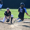 JIM VAIKNORAS/Staff photo Triton's Grace McGonagle is caught stealing second against Arlington Catholic at Martin Field in Lowell.