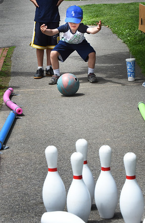 BRYAN EATON/Staff Photo. Joseph Scorcia, 5, of Newburyport  tries his skill at bowling at Amesbury Days' Kids Day in the Park.