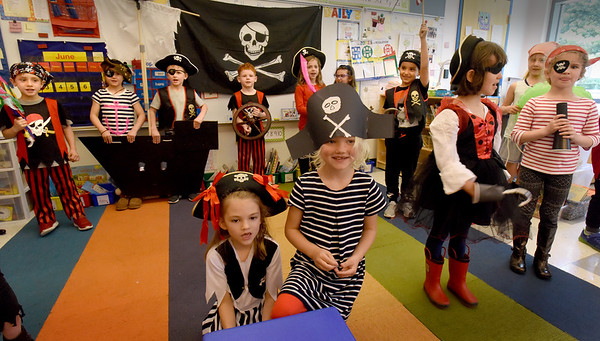 "BRYAN EATON/Staff Photo. Kindergartners in Sherry Herzig's class perform the musical play ""A Pirate's Life For Me"" on Thursday afternoon. They had been learning about pirates and presented the play to their parents."