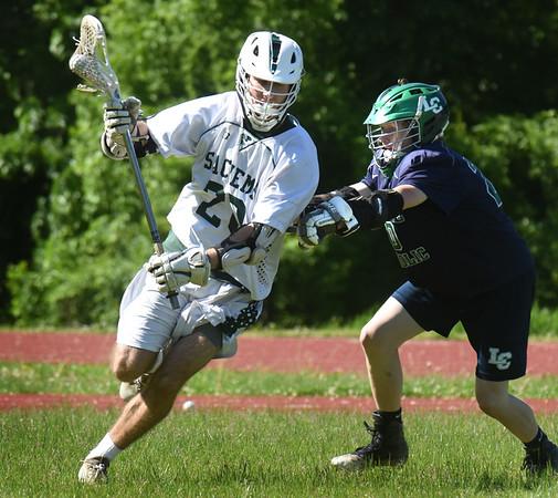 BRYAN EATON/Staff Photo. Matt Keeves moves around a Lowell Catholic player.