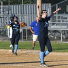 JIM VAIKNORAS/Staff photo Triton pitcher Katharine Quigley tosses her glove in the air after the Viking's victory over Arlington Catholic at Martin Field in Lowell.