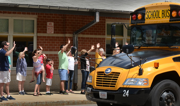 BRYAN EATON/Staff Photo. Teachers at Salisbury Elementary School wave to students as they leave on school buses on Friday morning. It was the last day of school for the Triton School District which includes Rowley and Newbury.