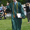 JIM VAIKNORAS/Staff photo Pentucket graduate Ryan Gallagher hold up his finger after getting his diploma at Commencement Saturday morning.