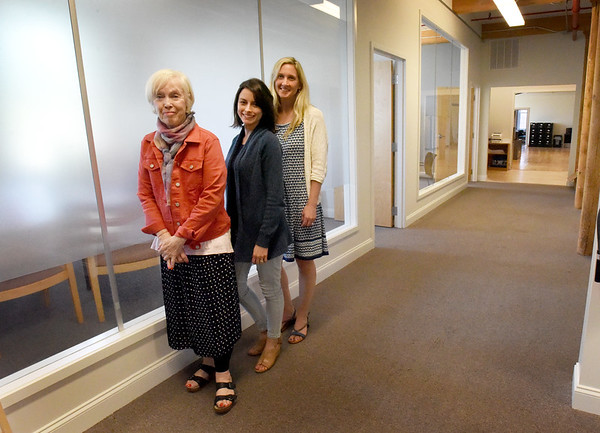BRYAN EATON/Staff Photo. The Pettengill House just doubled the space in their Amesbury office space on Water Street in the Lower Millyard. In the hallway of new office space, expanding from their older space in back, are from left, director Deb Smith, program coordinator Sierra Partlan and assistant director Tiffany Nigro.