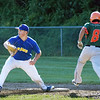 BRYAN EATON/Staff Photo. Rowley Rams first baseman Joe White waits for the throw as an Ipswich player nabs the plate.
