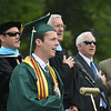 JIM VAIKNORAS/Staff photo Pentucket's Jack Clohisy leads the Pledge of Allegiance at Commencement Saturday morning.