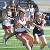 JIM VAIKNORAS/Staff photo newburyport's Emily Fuller makes a move on Triton's Anna Behringer at World War Memorial Stadium in Newburyport Friday.