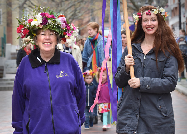 BRYAN EATON/Staff Photo. As she has for 35 years, Newburyport Montessori owner Maureen Daley, left, with staffer Sarah Webb, leads the students down Inn Street for their annual May Day Celebration. After 48 years of ownership, she has sold the Newburyport school, but will continue in the area's acting scene.