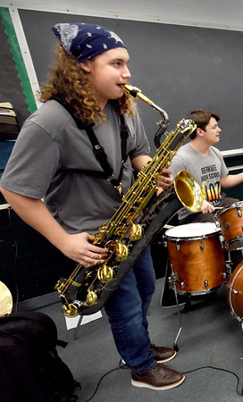 BRYAN EATON/Staff Photo. Zack Murphy rehearsing with the Pentucket High Jazz Band earlier this year.
