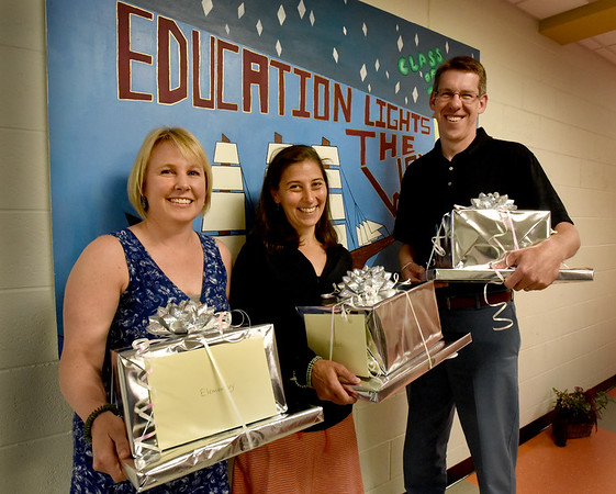 BRYAN EATON/Staff Photo. This year's Molin Awards winners, from left, Renee Ames for the elementary schools, Jen Groskin of the Nock Middle School and Brandon Sturma from Newburyport High School.
