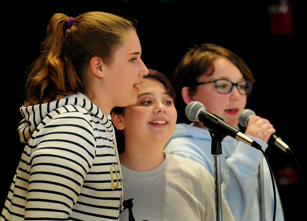 """BRYAN EATON/Staff Photo. Performing """"Better When I'm Dancing"""" by artist Meghan Trainor, are, from left, Madison Hamlin, Hannah Barter and Sydney Ward, all 12. They were performing at the  Pine Grove School in Rowley where the sixth-graders held a talent show on Wednesday for the rest of the school."""
