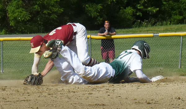 BRYAN EATON/Staff Photo. Pentucket's Andrew Melone makes it back to second after leading as Ryan Archie goes for the ball.